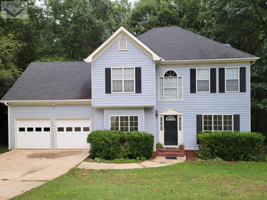 Don't miss this chance to see this lovely 4 bedroom 2.5 bathroom home in North Oconee school district! Walk into a 2 story foyer that opens onto a large dining room with hardwood floors. The main level also includes a family room with fireplace, eat-in kitchen and formal living room/study. The kitchen is open and airy with tons of counterspace and storage. Off the kitchen is the laundry room which leads to the 2 car garage. All bedrooms are upstairs, each with so much natural light! Master bedroom has a trey ceiling, walk-in closet and huge en-suite with jacuzzi and separate shower. This home also has an unfinished basement that is connected to the HVAC system so it could easily be finished and add 1000 sf to your living space. As it is, it's an awesome space for a workshop, man-cave or craft room. All of this and NO HOA! Schedule your showing today!