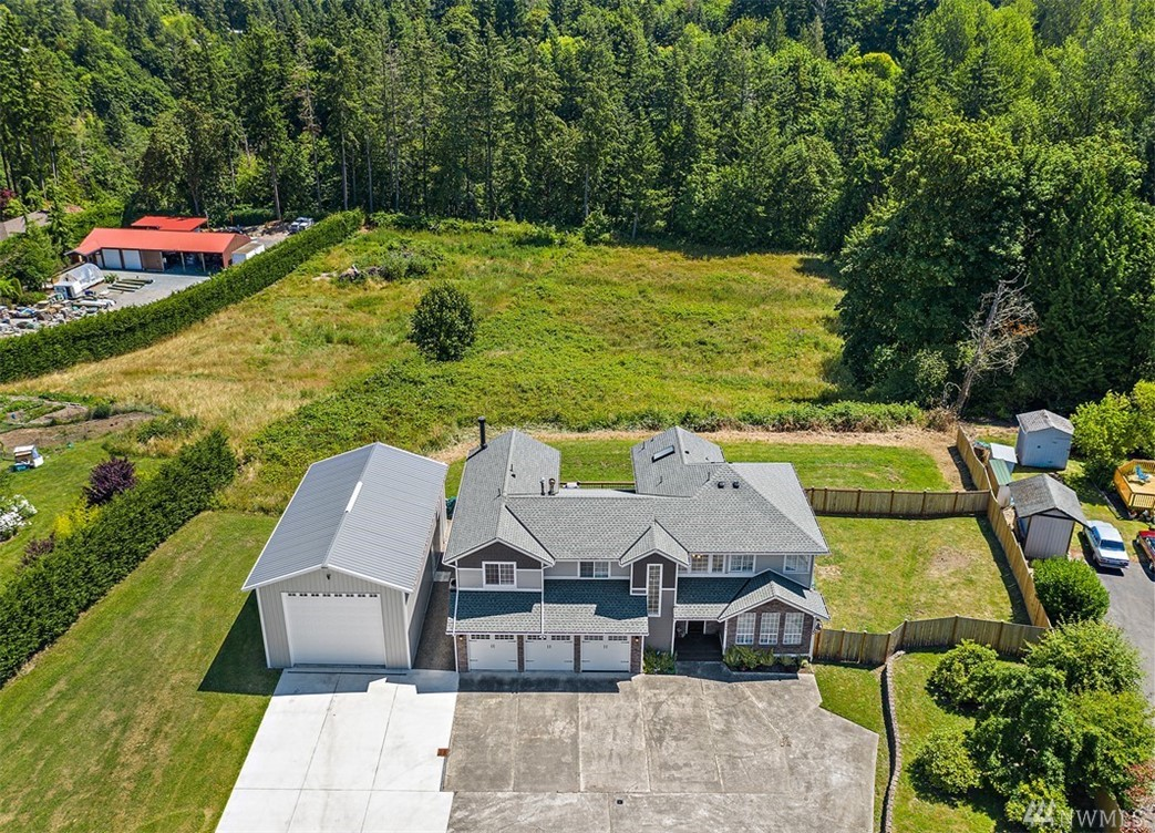 Stunning light/bright open concept home w/vaulted ceilings on 2.3 acres! New roof, gutters, crawl space, heat pump, & huge shop w/ RV hookup! Relax on the back deck that runs the width of the house w/ a hot tub & gazebo. 3190 Sq Ft w/ 4 bdrms/2.5bths, bonus room in garage, & open railing staircase that overlooks main floor. Beautiful & large kitchen w/ island, granite, stainless appliances, backsplash & pantry. Master suite w/FP, 5pc bth, & deck off master. This property has it all-see it today!