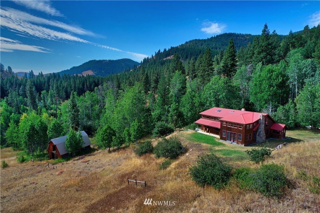 Magical Methow Retreat part of historic Diamond T Ranch. Enjoy serenity w 40 acres overlooking open fields, quaking aspens & pondorosa pines on Little Cub Creek. Timeless, well designed open floor plan w/ redwood ceilings & cedar walls. Kitchen w maple counters & Wolf Range. 3bd/2ba, loft, bonus rm, full basement & fixer classic barn. 2 parcels allow for multiple residences & outbuildings. Diamond in the rough ready for your finishing touches. Naturalist's sanctuary ski & hike out the back door!