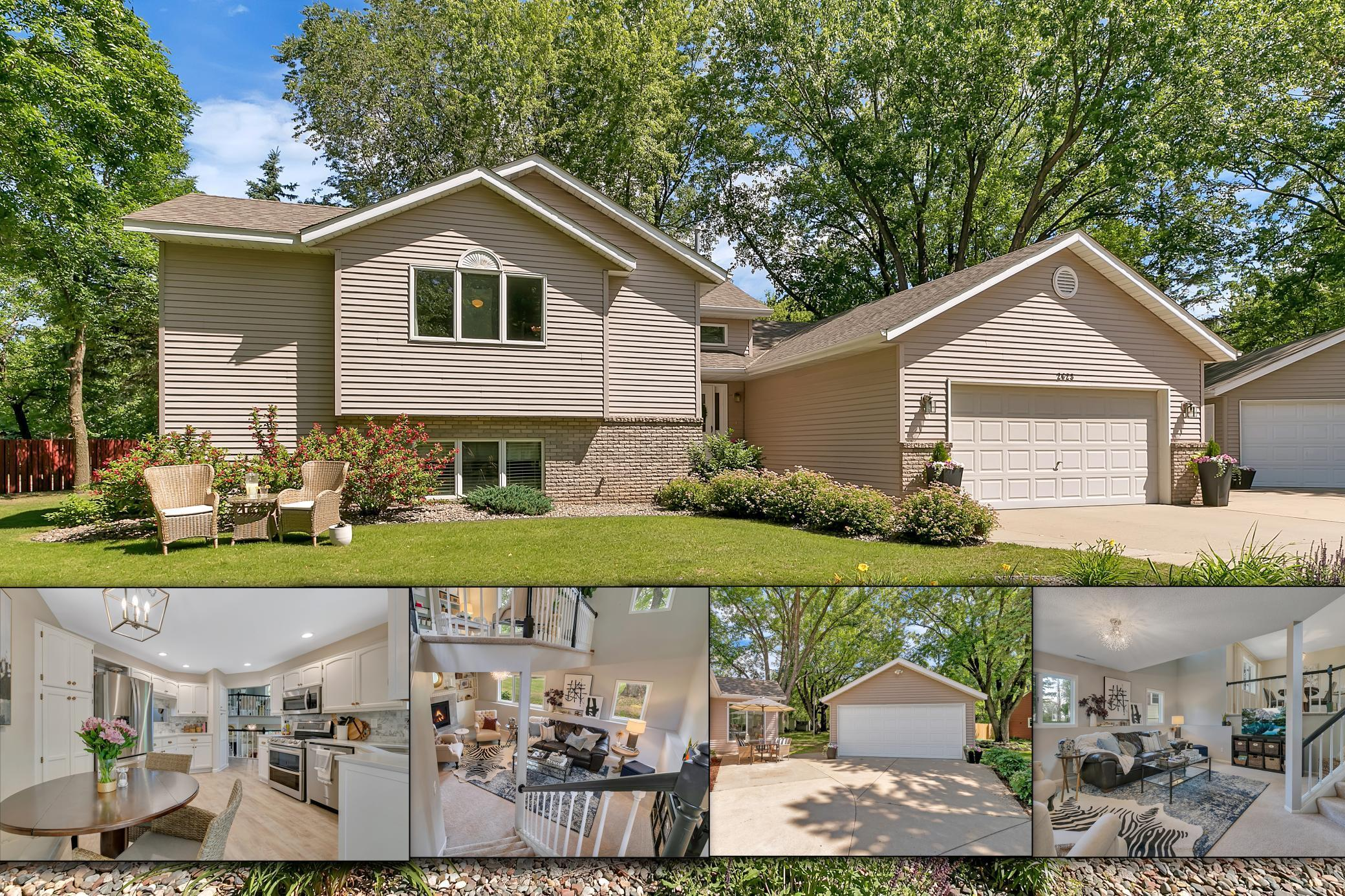 """This 4-level with unique floor plan has everything!! The newly renovated kitchen features designer touches. Enjoy the hard working quartz counters, chic marble backsplash, freshly painted cabinets w/Pottery Barn hardware, lighting, and window treatments. There is brand new luxury laminate white oak wood floors throughout the entire main floor. And the sunroom just off of the kitchen is bound to be your most used space! You'll love the tongue & groove walls and vaulted ceilings and wall to wall windows. Four bedrooms total; two up and two down. Wait until you see the master walk-in closet! His and hers closets with a celebrity worthy remodel of """"hers""""! Professionally designed and executed to be the ultimate luxury closet! The upper level living room has great built-ins and the lower level family room is sure to please with a cozy gas fireplace. The large 4th level has a 14x14 laundry plus lots of storage. Awesome fenced backyard and 10x16 storage shed. This home has it all! 4 car garage"""