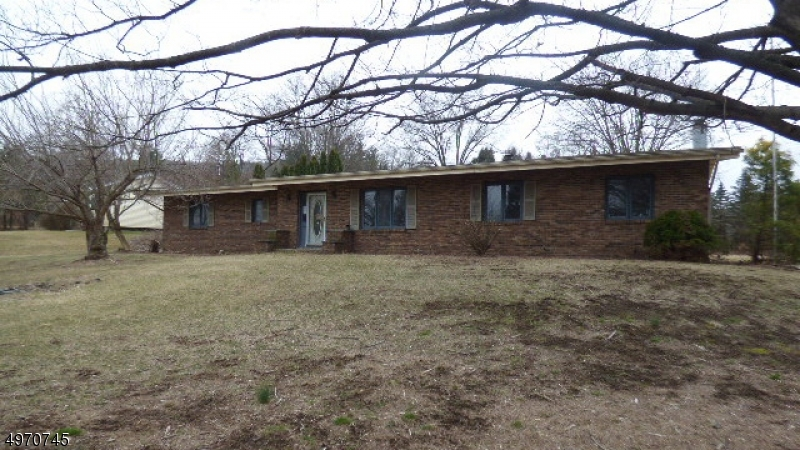 Nice brick ranch on a level open lot with 3 BR and 1.5 bath, fireplace, deck and an in ground pool with pool house. Sold  As Is, seller will not make any repairs. First look expires on April 2 only owner occupant offers will be considered during this time.   New hot water heater installed.  House needs updating.  In ground pool needs a new liner.