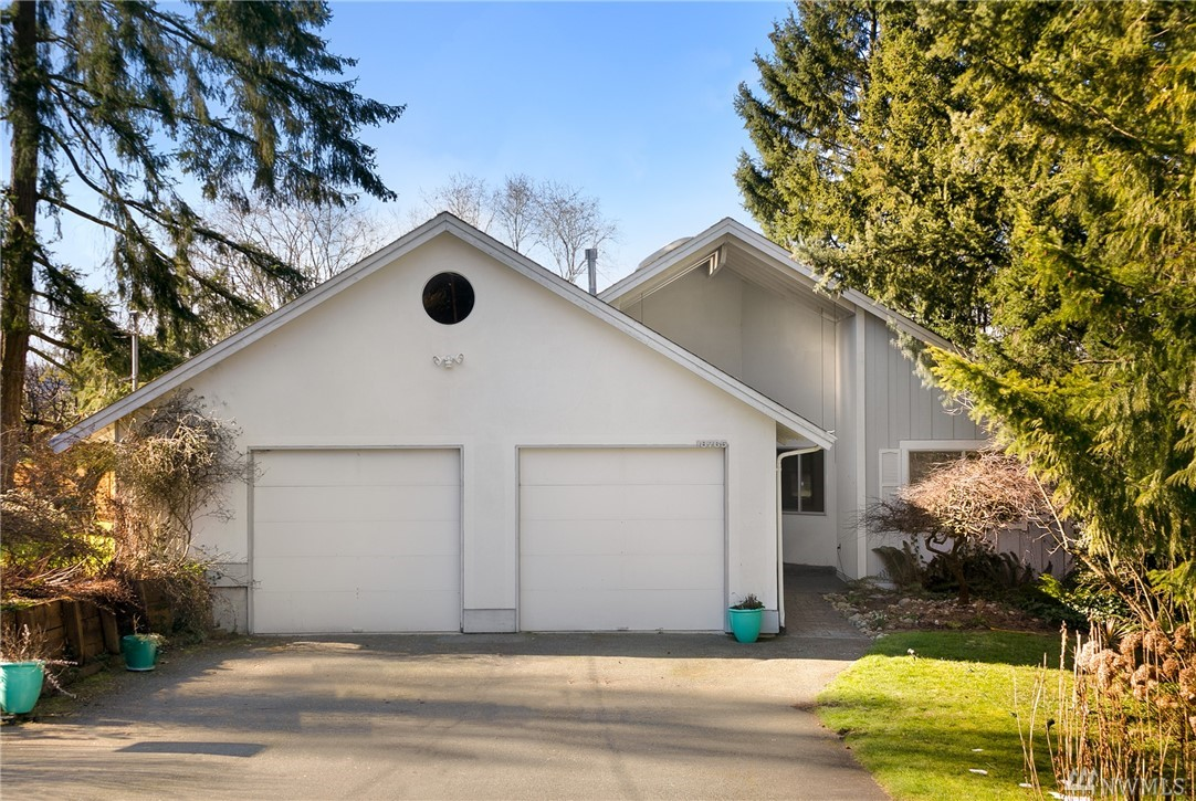 Northwest Living at it's Best! This beautiful & timeless 4 bdrm 3.5 bth home in the highly sought Lake Sammamish area w/beach rights. Too many features to list! Retreat to your main floor master bdrm or 2nd master bdrm upstairs. Lower level walk-out basement is perfect for a potential MIL suite with separate entrance.Stunning wall of windows fills this home w/natural sunlight.Open floor plan designed to capture the beauty of surroundings area.Close to Lake Sammamish,trails,shopping,I520 & Hwy202