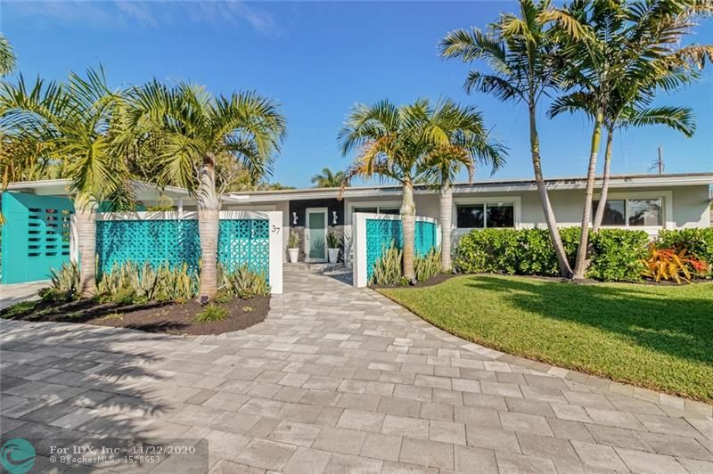STRIKING! Mid-Century breeze block & architecture welcomes you to this Wilton Manors marvel. A complete & modern redesign. Open concept living including great room w/vaulted post & beam ceiling & huge sliding impact door to private heated pool & spa. Large dining room open to chef's kitchen w/professional ss appliances & 5' wide built-in refrigerator. Ample pantry storage & 11' of quartz counter top to entertain in adjacent lounge. 4 BRs & custom closets w/glass paneled doors. The pool calls from the large slider in the gracious master suite w/9'x6' walk-In closet & 8'x11' dressing area. Impact windows & doors, concrete roof, water & sewer, paver drive, A/C, well & sprinklers new in 2016!  Custom hardwood outdoor shower, & tropical landscaping. All just a 10 minute walk from Wilton Drive.