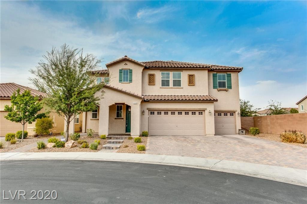Your search is over! This fabulous 2 story home in Inspirada, awaits for you! Clean and luminous interior offers great living room with fire place, formal dining and family room and a den. Kitchen is fully up-graded with double ovens, 5 burner gas stove, up-graded granite and backsplash, large pantry, new kitchen cabinets and stainless steel appliances. Master bedroom downstairs offers a full bathroom and walk-in closet and sliding door with access to patio. Unwind after a busy day while enjoying your favorite beverage by the pool. Backyard has sparkling, heated, pool and spa with rock grotto and waterfall, built-in BBQ with bar area and built in trampoline. Master suite upstairs, features 2 very large walk-in closets, beautiful large bathroom with vanity separate shower and bathtub. Loft upstairs, that can be a great game area or an office. Solar panels fully paid off, tile floors downstairs and hardwood upstairs.