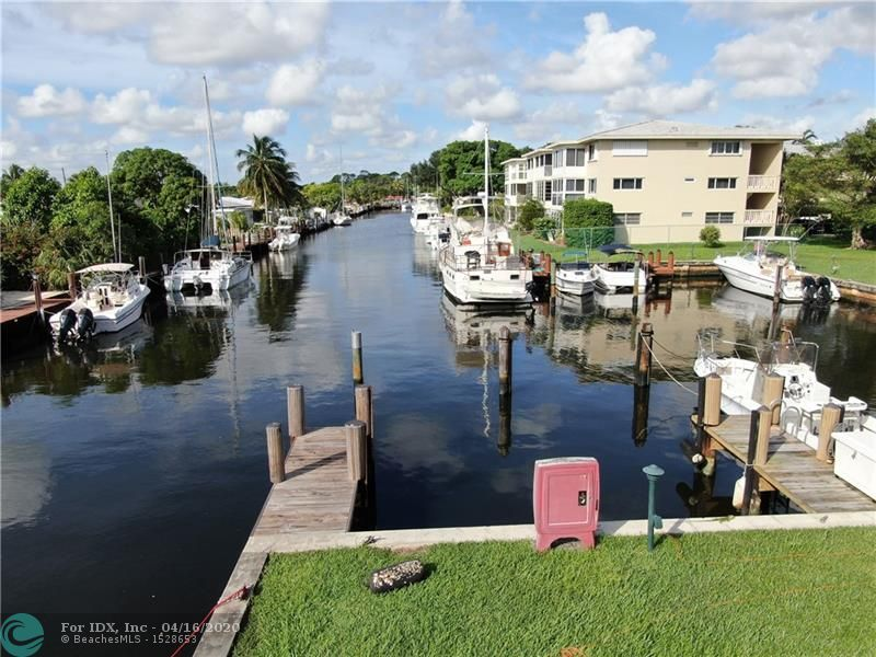 PRICE REDUCED! PRICE REDUCED AGAIN!!!   A 2/2 condo in tropical South Florida near the Intracoastal on a wide canal with ocean access, how much better can it get! Add to that a dock with a boat slip and this property should be right at the top of your must see list! Awesome location. Close to I-95, I-595, the airport, Port Everglades, the beaches, Las Olas, and downtown Fort Lauderdale! Also includes assigned covered carport.