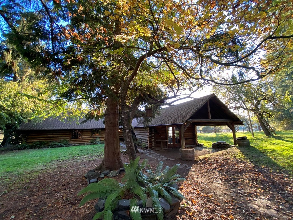 Authentic hand-hewed log home sitting on close to 20 acres. 1785 sqft, 2 Bed, 2 Bath w Rec Room and office space on septic and private well. NO CCR's or HOA's. 30 min to east gate of JBLM. AS IS property with Rustic charm includes gated drive, fenced paddocks, ponds, mature fruit trees, small horse barn and a large shop wired for 220 w/RV parking and extra storage.