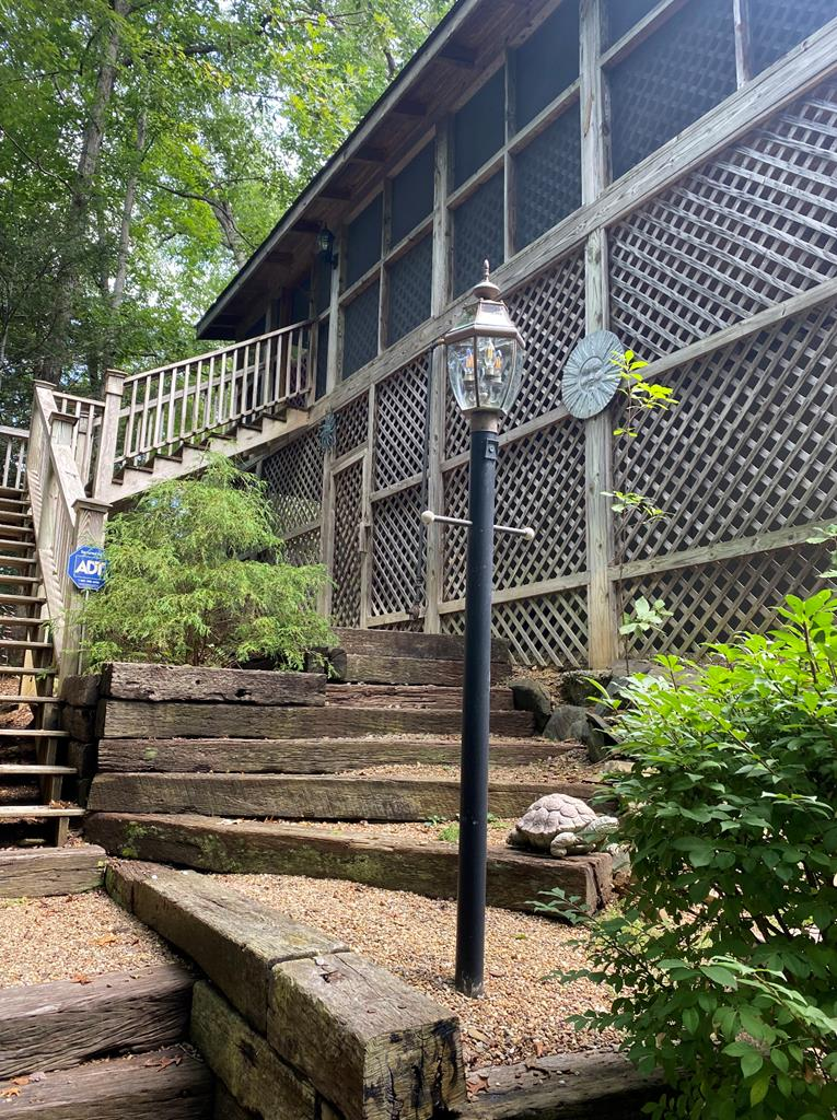 Enjoy being close to the Gatlinburg Arts and Crafts Community and minutes away from Rocky Top Sports complex!  This custom cabin is built solid.  No shortcuts.  3/4 plywood exterior, (NO CHIPWOOD). Own a side of the mountain with this 3 bedroom home.  One bedroom is a loft that over looks the family room with plenty of privacy.  This Cabin over looks Sugarland Mt. and seasonal views of Mount Le Conte.  All City Utilities and a private PAVED drive up to the cabin.  Enjoy a wrap around porch with a  screened in area.  Completely furnished! Gorgeous solid pine ceilings and beautiful hard wood floors. Minutes from downtown Gatlinburg, you can also catch a trolley near by.