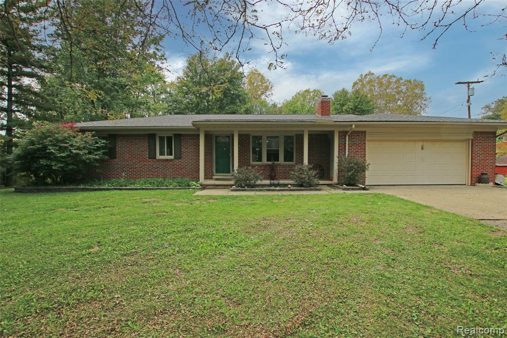 Awesome opportunity to build quick equity and purchase a great property at an affordable price!  Seller has taken care of the big things - new engineered septic in 2020 (over $50k), new roof in 2019, new furnace and central air in 2021, electrical panel updated and replaced, and removed damaged drywall and ceiling in basement.  Now it's time for the fun stuff!  Make this home your own with your cosmetic updates and personal touches.  Lots of great features in this brick ranch sitting on 5 acres in Groveland Twp.  Spacious rooms and everything on one floor.  Wood burning fireplace, central air, large deck, first floor laundry, and even a little office/study area.  Walkout basement offers an additional bedroom, full bathroom, and previously a second kitchen. Huge bonus is the 40x60 pole barn that offers 3 horse stalls, electricity, and an office area. Someone will snag this up quickly - so don't wait!