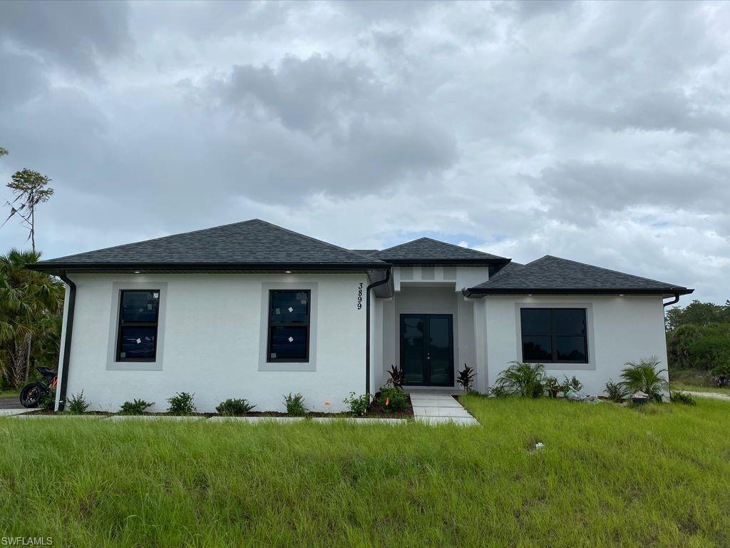 PRE-CONSTRUCTION HOME being built west of Wilson in the area of Golden Gate Estates, will feature 3 bedrooms + Den, 2 bath, & 2 car garage! Living area of 1,656 sq.ft and a grand total of 2,398 sq.ft. Upgrades include 24x24 porcelain tile throughout, crown molding, quartz countertops, stainless steel appliances, and solid wood cabinets! The kitchen will have 2 pantries. The living room and master suite will boast tray ceilings. Master wing will feature an oversized bedroom, 1 spacious closet, double vanity, and glass door enclosed shower. The outside of this home will not disappoint either with a beautiful landscape, auto sprinkler system, and a summer kitchen on the large lanai. Impact resistant windows/doors! Free REVERSE OSMOSIS upgrade if under contract by the end of October 2021! Your brand new future home will be ready by April 2022!