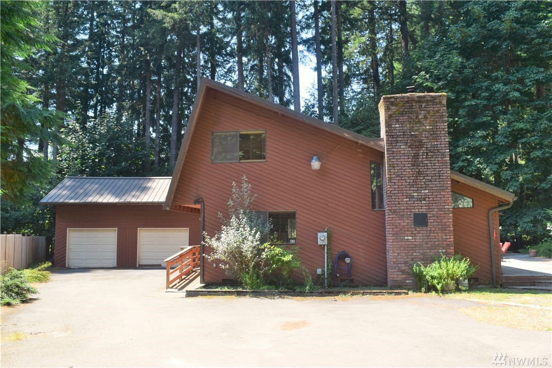 Exceptional cabin in Packwood WA. Close to HOA amenities such as pool, golf, clubhouse, Cowlitz river access. 30 minutes to White Pass skiing & Mt Rainier nat park. 2 1/2 hours to SEA & PDX. National Forest and hiking trails to river directly across the street. This property features 3 Bedrooms, 1.75 bath, large deck space with hot tub & gazebo, spacious garage with sleeping space above, fenced yard, fireplace, & more! Appliances stay & Furniture is negotiable.