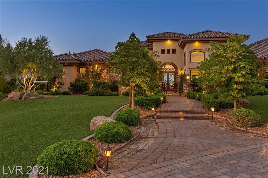 """Situated on nearly an acre lot in """"Rural Preservation"""" Henderson with no HOA, this custom estate provides a playground with easy access to Lake Mead, and numerous outdoor recreational sites. Built by a contractor for his family, only the finest of materials and construction design were used. With a rooftop deck that is over 2K sq ft, a chef's entertaining kitchen, designated home theatre, outdoor kitchen, disappearing walls, and single-story open floor plan this stunning home gives every desired contemporary lifestyle amenity for those who value privacy and space within close proximity to all Vegas has to offer."""