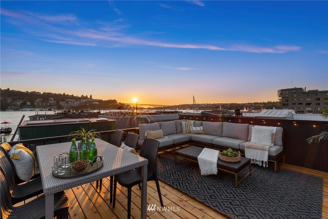 Soak up the sun from your rooftop deck as you take in the views from Seattle's iconic floating home community on Lake Union! Watch the city lights sparkle from inside where the views continue in all the main living areas. Relax and unwind in your fully updated home with upgrades that include all new fiberglass windows and doors, white oak hardwood flooring, paint, lighting, custom cabinetry and hardware, quartz countertops, new appliances, cedar decking and siding, and a new roof and gutters. Walk, bike, paddle board or take a boat straight from your home! Don't miss out on this rare opportunity to live ON the lake!