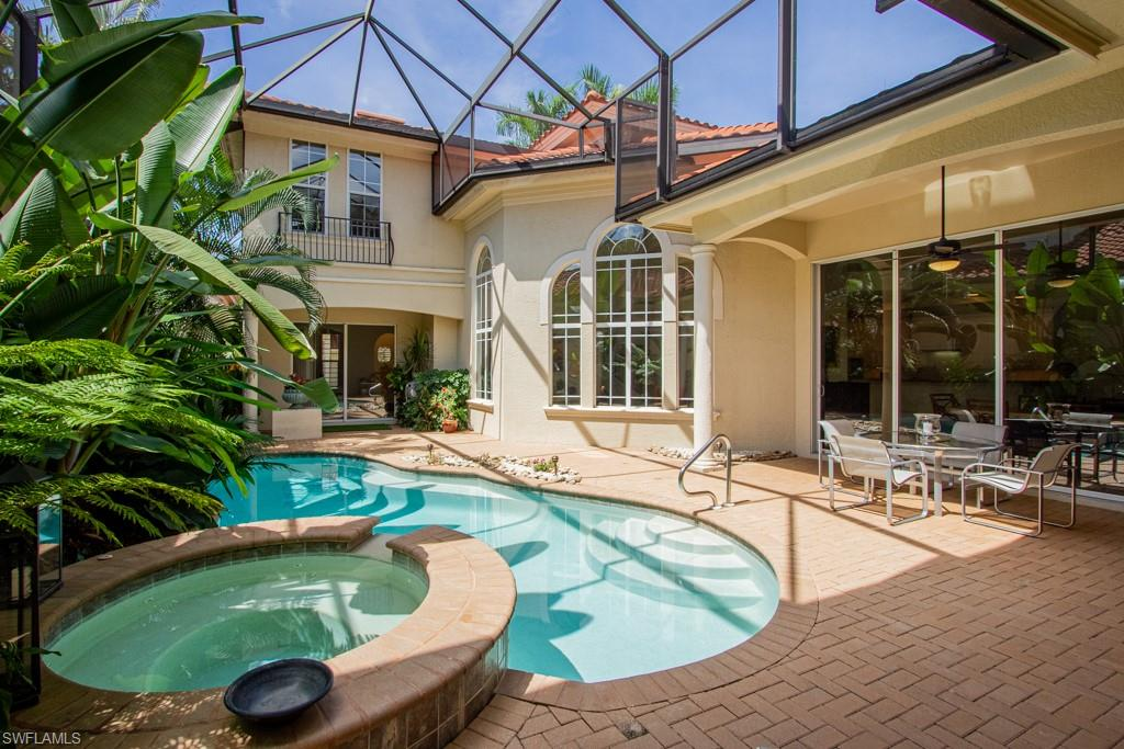 Majestic two story home in L'Ermitage in Grey Oaks. Enter the Grand Foyer and you are greeted with fabulous high ceilings, lots of light and a fantastic view  through the centrally located Living Room of the courtyard, pool, spa and lanai amid lush tropical landscaping.  The Family Room has a great area with a dining table and a wall of glass that opens to the pool area. The den has wood flooring. The Master Suite also has glass sliding doors to the terrific courtyard area and the Master Bathroom is a luxurious combination of marble countertops, beautiful wood cabinets and a roman-style tub. Your kitchen has a gas cooktop, granite counters, kitchen aid, stainless steel appliances and is a dream in which to prepare your favourite meals. The Casita is a wonderful guest suite for your company to stay and also has glass sliders direct to the lanai area and its own separate entrance to the main driveway!  Upstairs is another full guest suite. Grey Oaks is a really terrific community offering social and golf memberships, a great restaurant, pool area and many social activities. Welcome to the enclave of L'Ermitage!