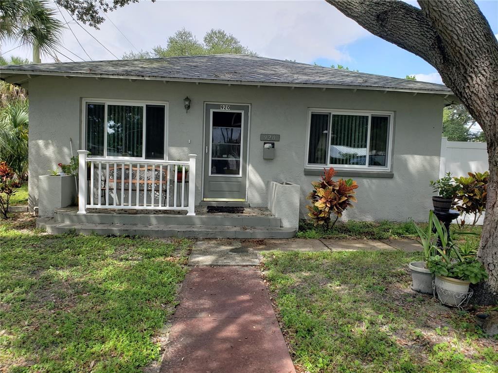 Lovely home located adjacent to the historic Kenwood area of St. Petersburg.  It's only minutes away from Tropicana Field and numerous restaurants.  Entering the living room you will notice the vinyl laminate flooring that runs through the entire home except for the kitchen and bathroom that have ceramic tile that matches the whole house flooring.  Improvements include:  vinyl laminate flooring and ceramic tile to match (2019), wood fence (2016), vinyl fence (2017), new hurricane impact windows (2019), hot water heater (2020), bathroom update (2019), painting (2020), new roof (2016), termite treatment (2015,2021) and kitchen updated (2019) including soft close drawers.  Property has an oversized (.26 acre) lot with 2 sets of double gates.  Owner has taken pride in the yard and landscaping, so don't miss this one.