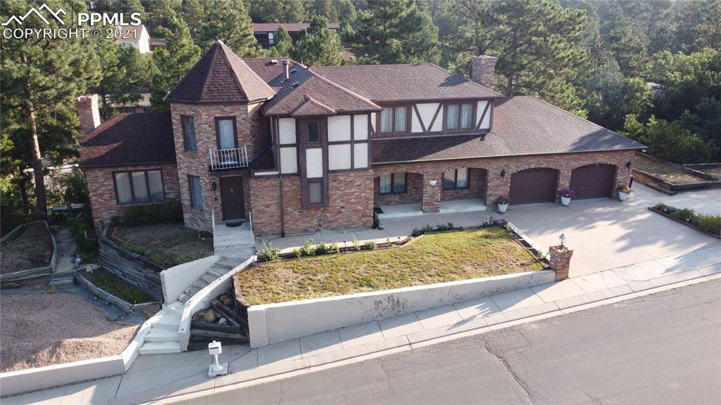 You will be impressed with this incredibly maintained 2 story home in the private Erindale area! This home has so much to offer that you will be impressed. As soon as you pull up you will be love the size of this home as well as the incredible turret where the front door is located! As you enter you will take it all in and have a hard time deciding which way to go to start your tour! On the main level you have a living room with a fireplace, a family room with a fireplace, two half baths, a large recently updated kitchen with tons of cabinets and countertops, and an incredible sunroom with lots of windows and 10 skylights! Upstairs you have an amazing office with built ins located inside the turret as well as a full five piece hall bath, two other bedrooms and a spacious master suite with attached five piece bathroom and two closets! In the basement you can another living room with fireplace and a family room, two more bedrooms, a full bathroom and a couple nice storage closets. Both the living room and family room walk out to the back patios, one of which is covered by the amazing sunroom above. You will love the trees and scrub oak around this property and the privacy it allows when you relax on the back patios. Central vac! 2 car garage and additional parking off to the side! Two of the fireplaces have never been used and they still have the original paper work inside them! Air conditioning upstairs only!