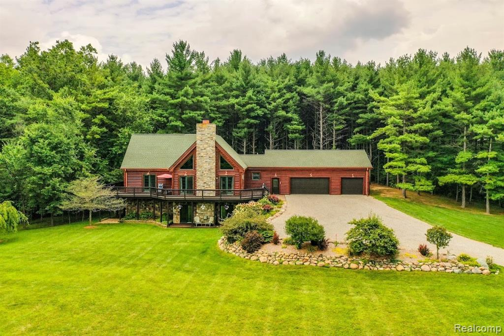 Once in a lifetime opportunity to live your dream in this spacious log home with finished lower level walkout on 10+ manicured acres.  Wooded behind sitting on the hill for lovely, panoramic views, 2 story, stone fireplace, wrap-around decking, additional 30x40 pole barn, 3 car heated attached garage, 12x12 storage room, 16x24 second garage with 10' ceilings and cabin in the woods.  Solid cedar, 2x6 construction.  Call for the full list of amenities galore!