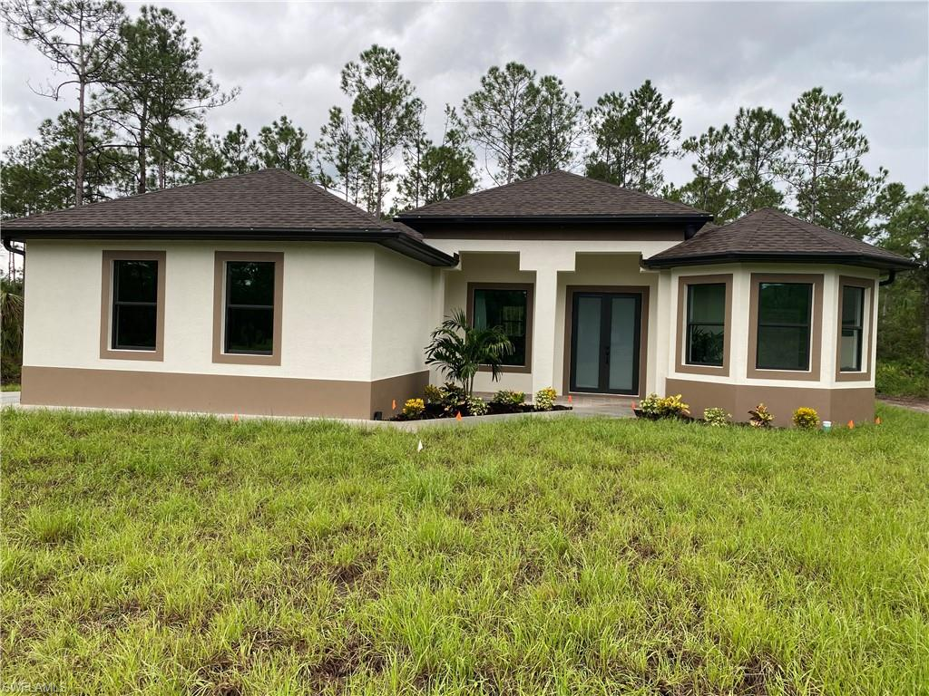 NEW CONSTRUCTION......BEAUTIFUL 3 BEDROOMS, 2 BATH AND 2 CAR GARAGE SITS ON 2.5 ACRES LOT........THIS BRAND NEW HOME ALSO FEATURES A BRIGHT & OPEN FORMAL LIVING & DINING ROOM,IMPACT WINDOW,GRANITE COUNTER TOPS, STAINLESS STEEL APPLIANCES, TILE FLOOR AND CROWN MOLDING WITH SPLIT BEDROOM, WALK-IN CLOSET IN MASTER BEDROOM, TRAY CEILING, AUTOMATIC IRRIGATION SYSTEM , ASPHALT DRIVEWAY AND MORE....BRING YOUR FAMILY AND YOUR PETS AND MAKE THIS HOME AN AWESOME PLACE TO LIVE . VERY PRIVATE AND CONVENIENTLY LOCATED NEAR SCHOOLS AND SHOPPING CENTERS.HOUSE IS READY TO MOVE.