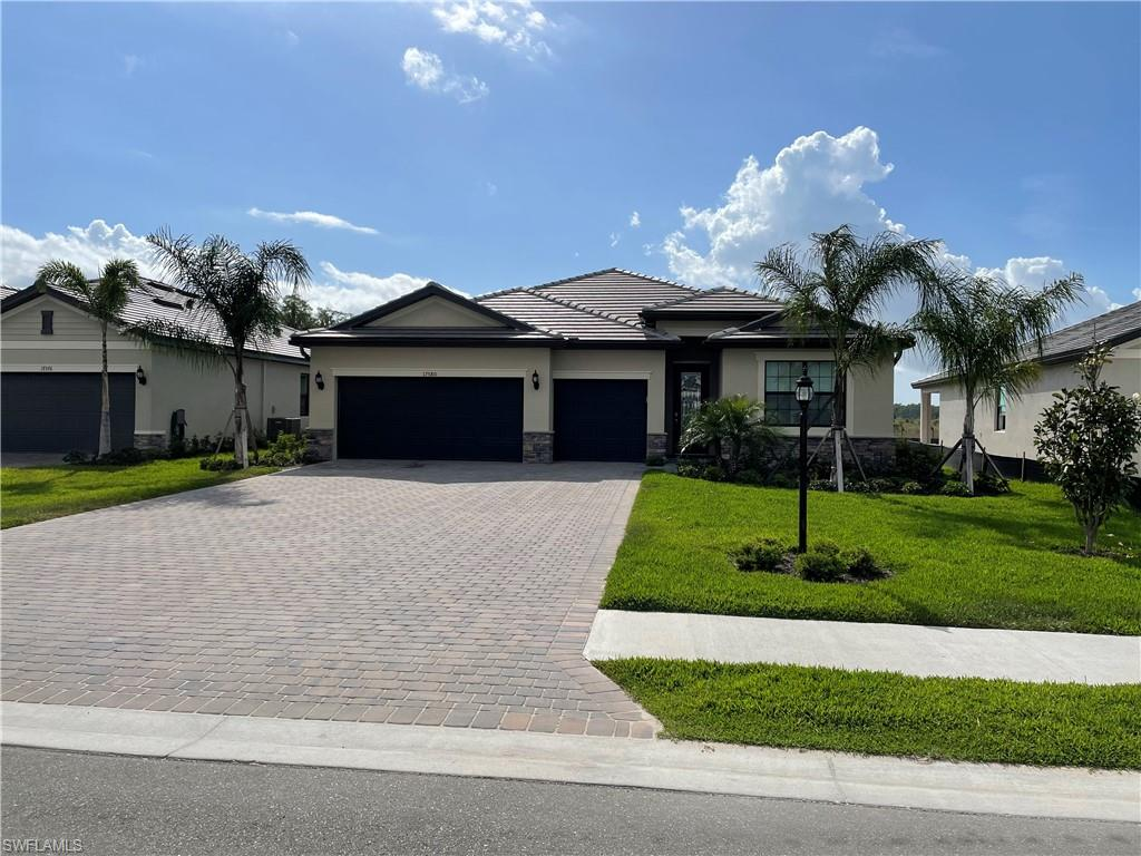 """Located in Estero at """"The Place at Corkscrew"""". This home backs up to the Preserve giving you privacy, yet a sense of living in paradise. The 4 bedrooms create space for a big family or a lot of guests. The kitchen was upgraded with stainless steel appliances, white cabinets, backsplash, and under-counter backsplash. The house has elegant lighting fans and crown molding. It has a 3 car garage The Place at Corkscrew is a resort-style community, which includes a 12,000 sqft community pool & spa, rock waterfalls, cabanas, water slide, splash pad, fire pits, beach volleyball, restaurant & martini bar, pool bar, 2 story fitness center, aerobics studio, kids club, massage therapy room, café & Marketplace, Tennis pro shop & courts, Bocce & Pickleball courts, basketball, playground, and dog park! The Corkscrew corridor is located just near to all the places you need to go: SW airport, Miromar Outlets, Coconut Point Mall, Gulf Coast Town Center mall, Publix supermarket, and restaurants/dining."""