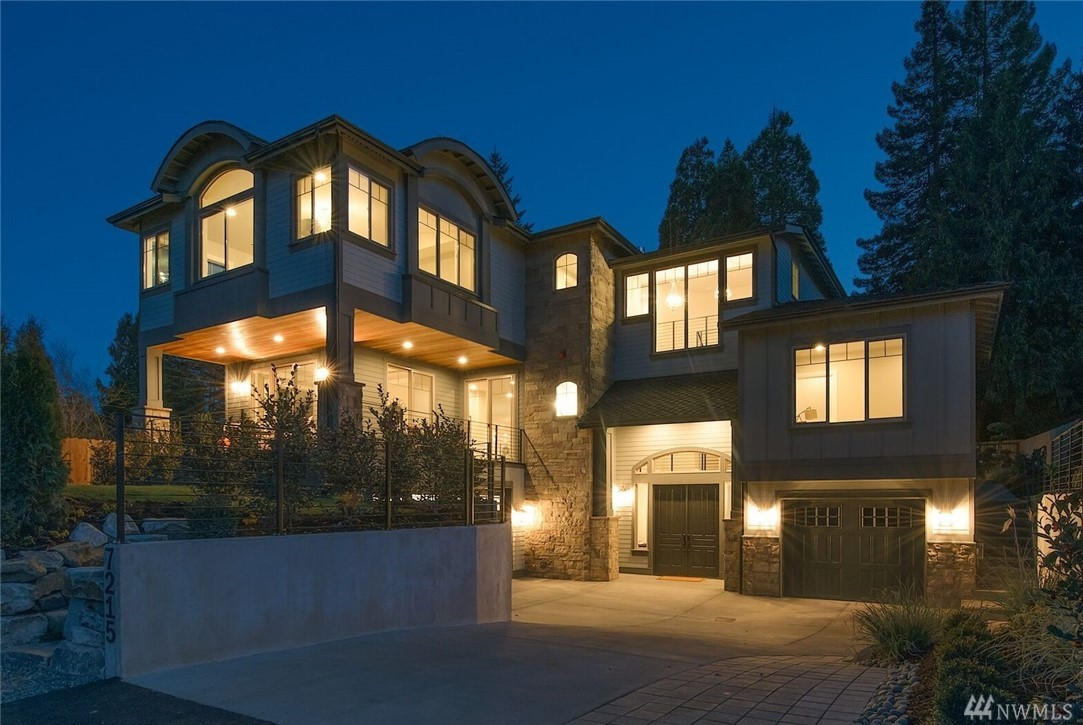 Absolute showstopper w/highest level of custom finishes imaginable crafted by Jabooda Homes. Classic Chateau style meets NW Rustic Contemp.Formal Foyer boasting vaulted ceiling leads u to Great rm on main flr w/10'ceiling. Chefs kitchen w/center isld&nk,formal dining open to covered deck. Master suite w/view of Lk&DT. Guest suite w/french dr adjacent to coveted patio ideal 4 grand outdr living,3 more suites,Media rm & Elevator. Live urb. life while maintain. neighborhd connections to pks/beach.