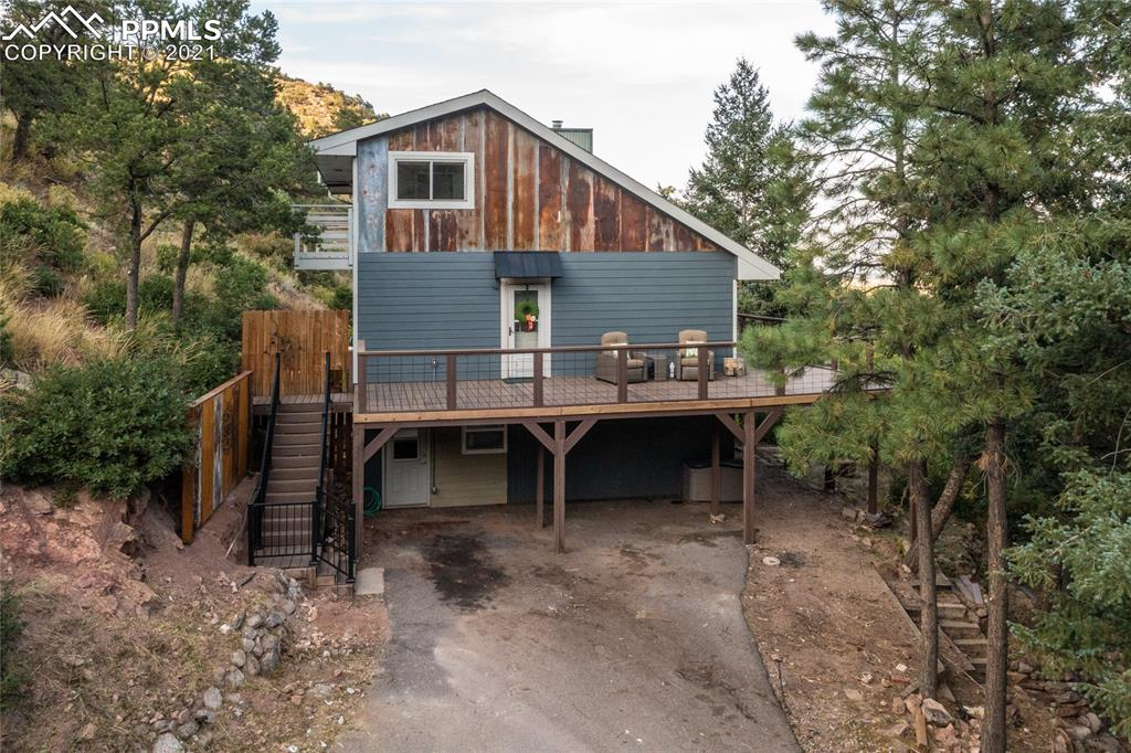 Why I love this home: Absolutely fantastic location, Mountain living so close to town!!! Just past the Crystal Park gate first home. Renovated home with giant amount of outdoor living and composite deck space. City lights, mountain views, trees, wildlife, privacy but not secluded and not an hour from town, cooler temps in the summer, beautiful colors in the fall, just plain peaceful! Sutherland creek runs year round just outside your door, you can hear it everyday from the deck. Steam shower in primary suite!! Crystal Park's gated community offers so much! A seasonally heated pool, private pond for fishing, and world class views, annual social events like Fishing derby and Chili Cook off and access to trails into PPNF. New carpet, new LVP, new paint in much of the house.   Something to understand about this lot. It feels like you have a few acres because of the way Crystal Park was developed. The community has 2000 acres there are 360 memberships/lots, and large amounts of open space. The exterior paint and siding will be completed prior to closing.