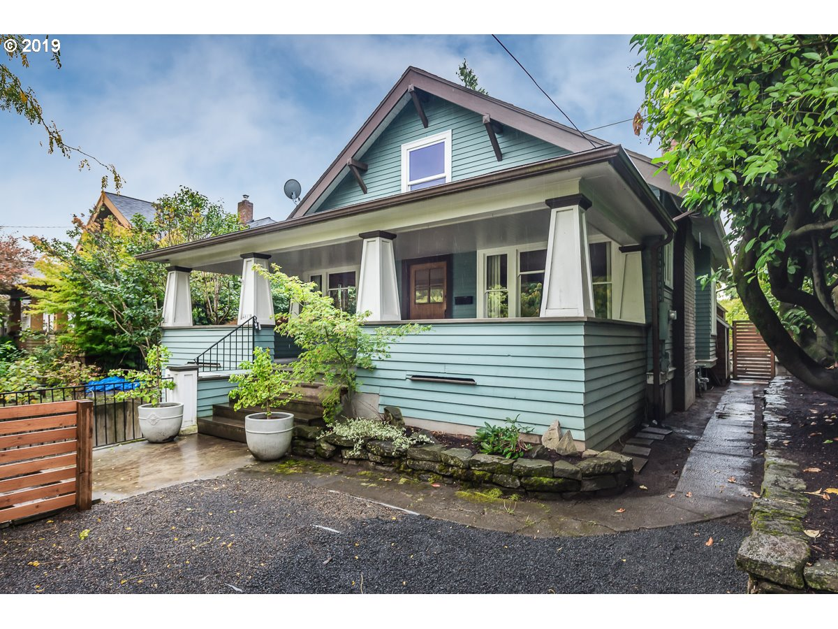 Spacious craftsman bungalow w inspiring architectural detail. Expansive front porch, fireplace, large living/dining & parquet floor.  2 beds on main and suite upstairs w bath, nursery/office & walk in closet. Set back & above street & lives quiet & serene. South facing back yard is sunny outdoor space. Off st parking & tuck under garage. Basement potential- ADU, living space or garage. Laurelhurst/Grant. Come & see it will surprise you! [Home Energy Score = 3. HES Report at https://rpt.greenbuildingregistry.com/hes/OR10049397]