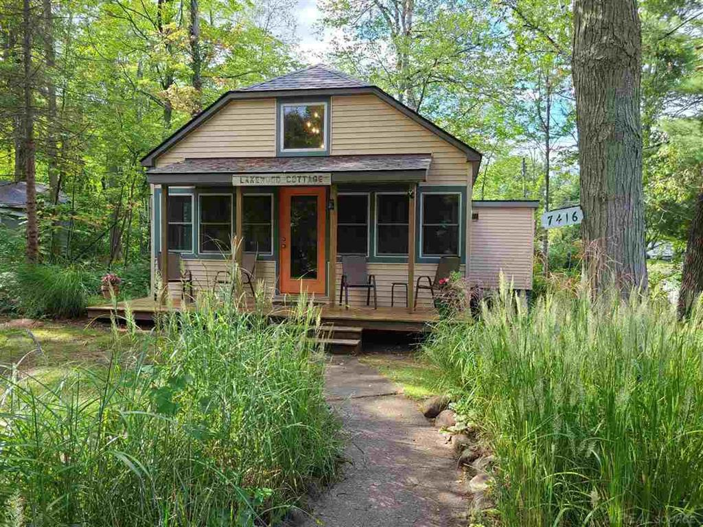 SANCTUARY BY THE SOOTHING WATERS OF LAKE HURON. Open concept cottage with vaulted ceilings, skylights, bedroom with a sleeping loft. Corner lot with mature trees and landscaping. Lake Huron is just a block away. Currently used as an AIRB&B, showing times may be limited to weekdays.