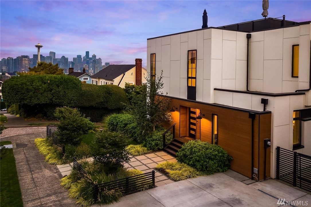 Stunning NW modern masterpiece with commanding views that only the South slope can afford. An entertainer's dream with expansive open main level that effortlessly blends livability and privacy while taking full advantage of the spectacular views. Unique features include a lovely master suite with sitting room, multiple offices, media rooms, and a home gym. Incredible 700 sq ft rooftop deck and rare 6900 sqft lot provide a once in a lifetime opportunity. This is the home you have been waiting for