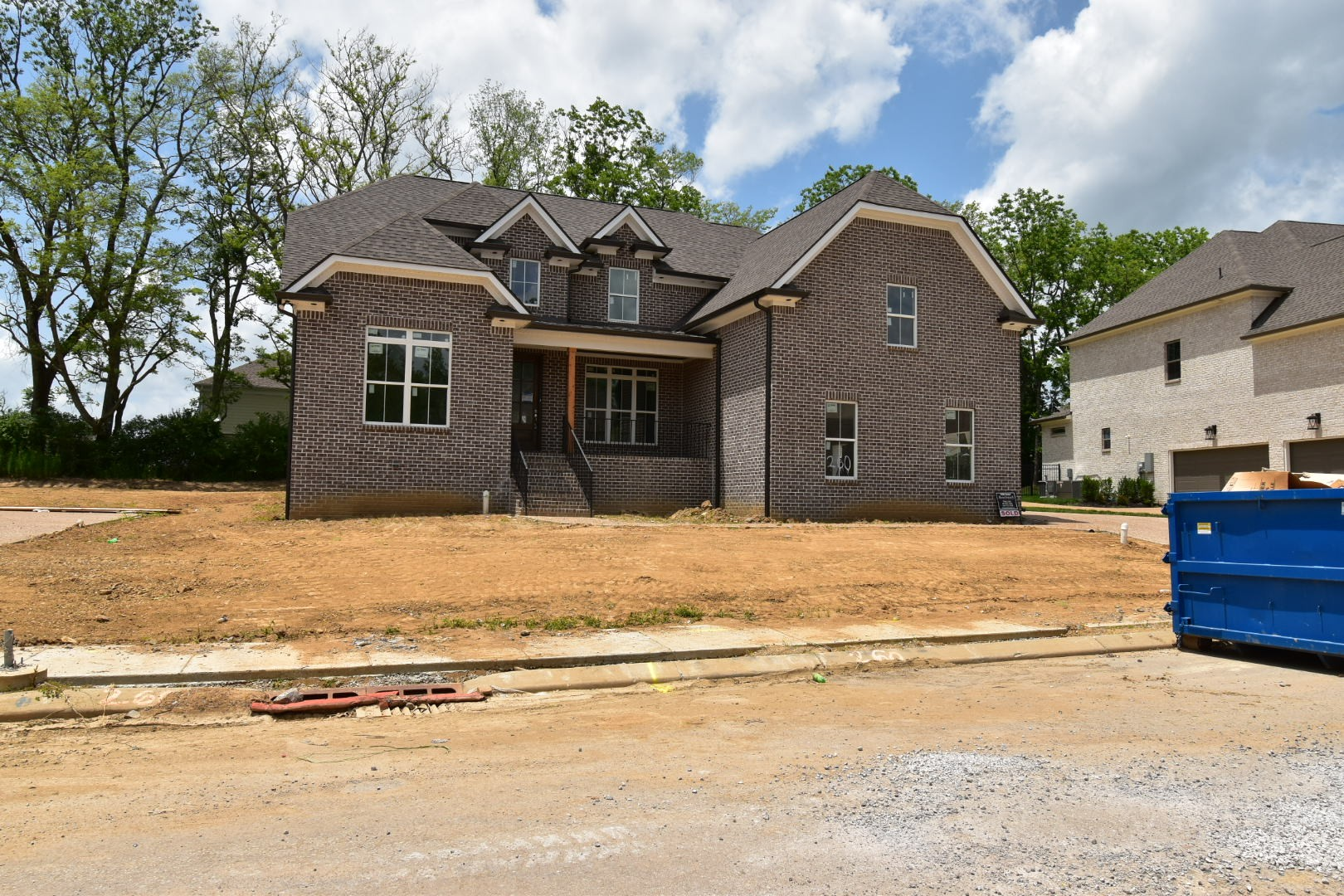 All Brick home by Landmark Building Co backs to mature tree line. Beautiful 2 Story Foyer, Open Family rm w/ cedar mantel on FP; Shiplap breakfast room wall; Open kitchen w/ large walk-in Pantry; Open Formal DR w/ Butlers Pantry; Master & Guest suite on main; Spacious BR's up; Lots of closet space w/ 3 hallway linen closets; Step down Bonus Rm w/ wet bar & Closet; Tile surround tubs in secondary bathrooms; Walk-in attic storage space; Covered back porch steps down to patio.
