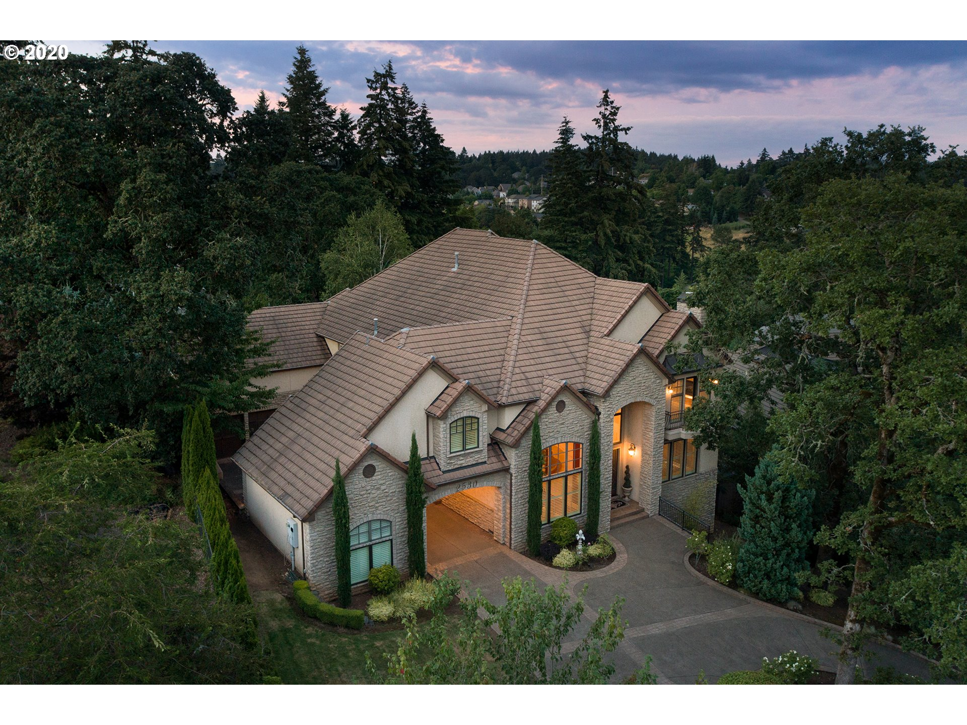 Majestic French Mediterranean estate in the exclusive gated community of Le Chevalier, West Linn. House is in impeccable condition with porte-cochere, circular driveway & multiple garages. Grand staircase, vaulted ceilings & exceptional custom millwork in this 6 bedroom masterpiece. Separate entrance apartment w/  kitchenette, amazing home theater, incredible stone wine cellar, home gym, gourmet kitchen w/ subzero, Viking oven. Covered expansive patio for indoor/outdoor living w/ Mt. Hood view.