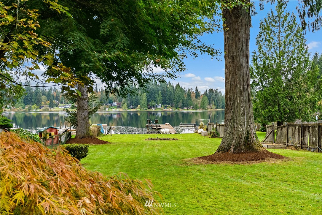 Destination Waterfront w/ an affordable price tag in highly sought after Eastside of Lake Joy Community.  Minutes from Duvall & Carnation or up over the hill to Redmond. This cozy 60's ranch style cottage is well designed to bring in lots of PNW light, beautiful lush views of shy 1/2 acre level lot & 50ft of lakefront. 3 Bedroom 1.5 bath living & dining room w/ built ins for that stay at home work schedule or home schooling. Large patio off dining room is great for entertaining or enjoying views of Lake Joy. Attached 1 car garage w/ shop, outbuildings, long dock w/ attached swim dock all situated on the Eastside of Lake Joy. Fresh interior & exterior paint updated features throughout, this home is just waiting for your personal touches.