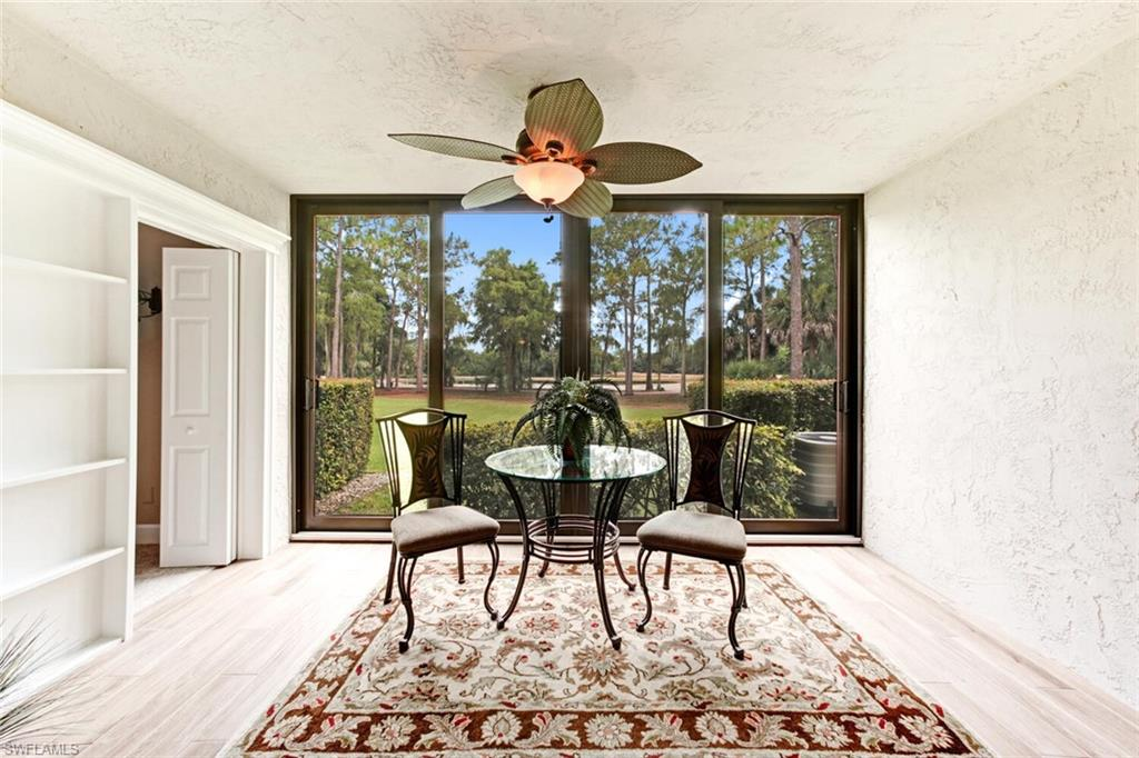 BEAUTIFUL COMPLETELY REMODELED, 1ST-FLOOR UNIT IN COVETED FOXFIRE COUNTRY CLUB! Recognized as one of the finest bundled golf communities in all of Naples, this totally renovated unit offers high end granite counters in the kitchen & bathrooms, along with upgraded cabinetry, newer appliances & large stainless-steel sink. All new carpeting installed May 2021. Brand new water heater & HVAC unit. Dedicated storage & carport also included. Relax & unwind on the newly enclosed lanai with impact glass windows overlooking the serene lake & golf course. The master bedroom boasts an en suite bath with walk-in closet & spacious shower. Situated in a low-density building with a convenient elevator. Amenities include a community pool/spa & beautiful 27-Hole Arthur Hills-designed golf course. The club membership recently approved major construction projects including new golf course irrigation system, new grill room, dining areas & new fitness center. The community enjoys a robust social calendar. Additional amenities include 3 Har-Tru tennis courts & Bocce. A prime location just minutes from downtown Naples, the beaches & fine dining/shopping. This condo is a must-see!
