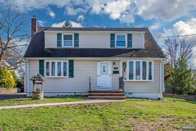 WELCOM HOME & GET READY FOR Entertaining and Summer Time Fun. Move in Ready Charming Cape Cod home that features: 3 BedRms,Eat in Kitchen w/ walkout to yard. 1 1/2 Bths ,LivRm/DinRm (or 4th BedRoom) Partial finished basement with walkout. Hardwood Floors UNDER /rugs..... .Central air.  Newer Furnace & water heater. Nice yard. Long driveway with garage / shed. Low taxes . Great home for Potential,  Conveniently located near schools, transportation ,restaurants, Major Highways and more. Home Protection Plan Warranty Plan INCLUDED 1 year.
