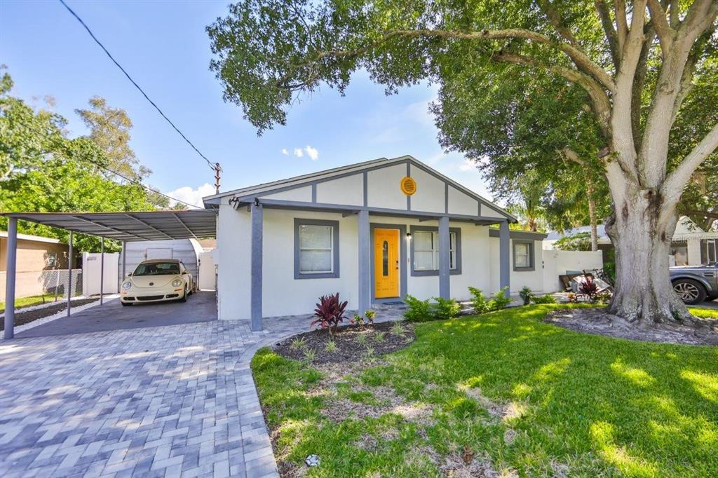 Location, location, location! Cute 3 bedroom home in the heart of everything. Minutes to the restaurants and shopping of South Tampa and downtown and only a block from Bayshore Boulevard. This home has all new wood-look tile throughout the whole home. Interior painted in 2019. Completely remodeled Ikea kitchen in 2020 with a 25 year warranty. Both bathrooms were remodeled in 2020. The third bedroom and bathroom plus small kitchen (fridge, microwave, and sink) has a separate entrance on the side of the house and also a lockable door to the main house. Use it as an in-law suite, kids quarters or even rent it out for extra income. BRAND NEW ROOF 2021. Exterior painted 2020. Tankless water heater 2019. Outside you will find a huge extended patio area with covered lanai and a fully fenced large yard. Irrigation system installed 2020. Keyless entry front door. Car port will fit two cars plus two paved driveways with tons more parking. Centrally located in Tampa and close to MacDill AFB.