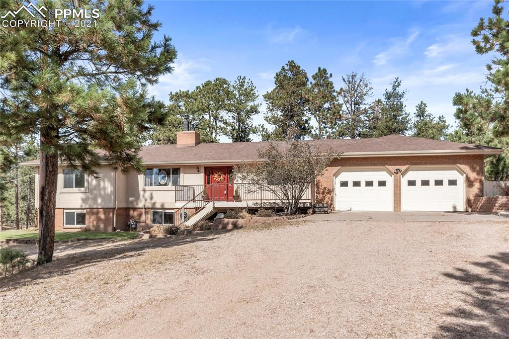 Built for a lifetime & meticulously cared for by one owner, your forever home in D-20! Peaceful 2.5 acres offers more than 4000 sq ft plus 2 story, stuccoed garage w/ 11' overhead door for 5th wheel RV! Tasteful updates  throughout including recent remodel of all baths! Guests will enjoy new composite decks in front & rear, two family rooms w/ gas log fireplaces plus formal living & dining rooms! Stunning beamed vaults, built ins and skylights add beauty to form in this functional home with amenities too numerous to list!