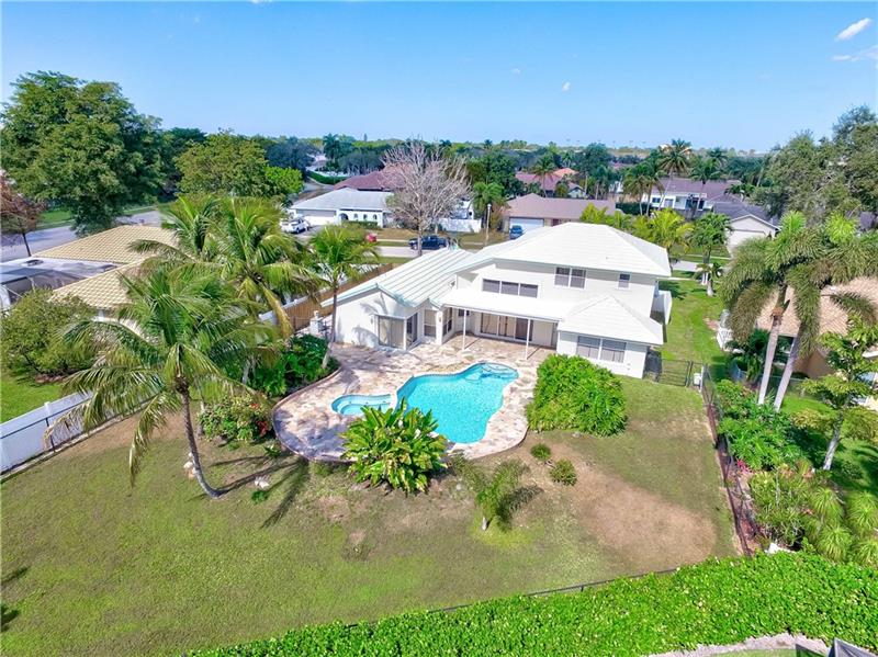 Welcome to this Tropical Paradise in Plantation Harbor! This residence is set on a quiet street in a lovely & tranquil neighborhood.* NO HOA*This home features an open floor plan spacious, bright and airy. Kitchen has lots of cabinet space, a pantry, snack counter as well as a breakfast nook that has a* perfect view of the pool area.* This home has been immaculately kept & awaits its new owners. Step into your own paradise with an amazing pool/spa and yard perfect for entertaining family and friends. Oversized fenced backyard - great for pets, kids & privacy. RV or Boat parking on the side of the yard behind the fence. Walking distance to nearby schools and Heritage Park. Mins to FL Turnpike,595,I95, Nova, Broward College & FAU in Davie. *15 minutes to the beach *15 minutes to the airport