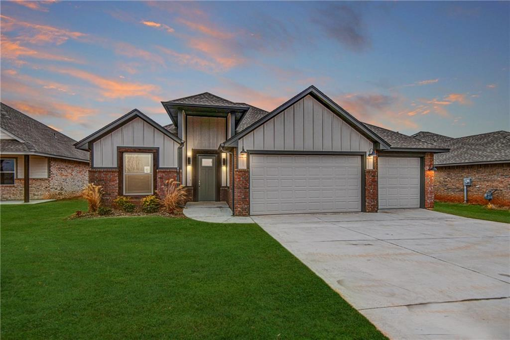 This brand new Edmond home is absolutely gorgeous! Stunning exterior with brick, accent colors, and stained trim work.  Huge open floor plan with wood look tile and a marble patterned tile fireplace with builtin shelving on either side. Kitchen features modern cabinetry, convenient breakfast bar, and a large pantry. Tray ceilings in master suite with a barn door leading master en suite. Master en suite features double sinks on a granite vanity, a walk-in shower, and a large soaking tub. Spacious laundry room with counter space and cabinetry. Backyard features a covered back patio. This home is absolutely perfect!