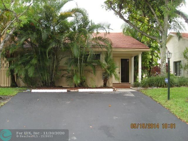 THERE IS NO PLACE LIKE HOME FOR THE HOLIDAYS- AND THIS IS THE PERFECT HOME. BEAUTIFULLY UPGRADED VILLA LOCATED IN JACARANDA COUNTRY CLUB.GORGEOUS LAKE VIEWS AND SUNSETS FROM YOUR PATIO. UPGRADED KITCHENS AND BATHROOMS. ACCORDIAN SHUTTERS. LOCATED ACROSS FROM SHOPPING, RESTAURANTS AND MAJOR ROADS.  A PERFECT PIECE OF SOUTH FLORIDA PARADISE.