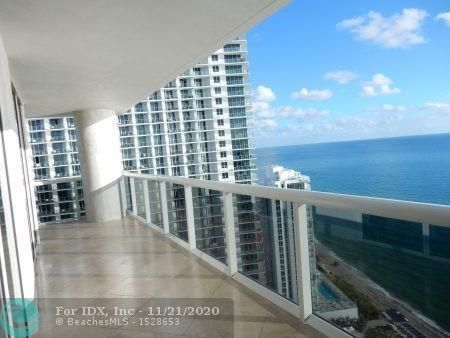 Corner high floor unit with breathtaking direct ocean and city view in modern 5 star ocean front complex. 3 bed, 3.5 bath unit, 2,078 sq. ft. plus 464 sq. ft. wrap around terrace. Marble floors, European kitchen, and floor to ceiling windows. The building features a huge 50,000 sq. ft. full service spa and fitness center with top of the line equipment; poolside bar with food service; full time concierge; and 24 hour valet parking. Building sits on a 9 acre site with 810 ft. of ocean frontage.