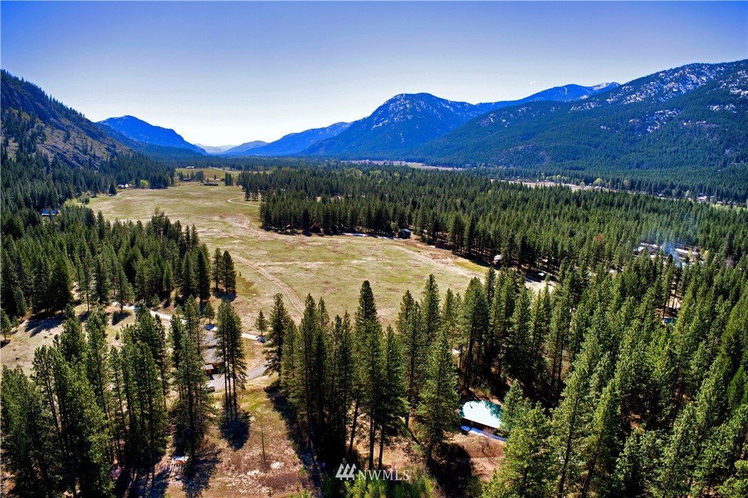 Rare, exceptional 7 Acres with the ski trail winding through.  Enjoy the fixer home or build your dream home on this spectacular acreage. There are endless Goat Wall and sunny meadow views with a perfect mix of ponderosa and aspen trees. Great space for a dream garden or continue the low maintenance landscape. Walk to the Mazama Store, hike, ski, and bike from your door and enjoy all that Mazama has to offer.  Great trail access right out the door for skiing, (landowner passes included)  hiking, and running. This large property currently has two homes on it, so many opportunities to remodel and/or build. Don't miss out on this amazing opportunity to own the most prime location in Mazama!