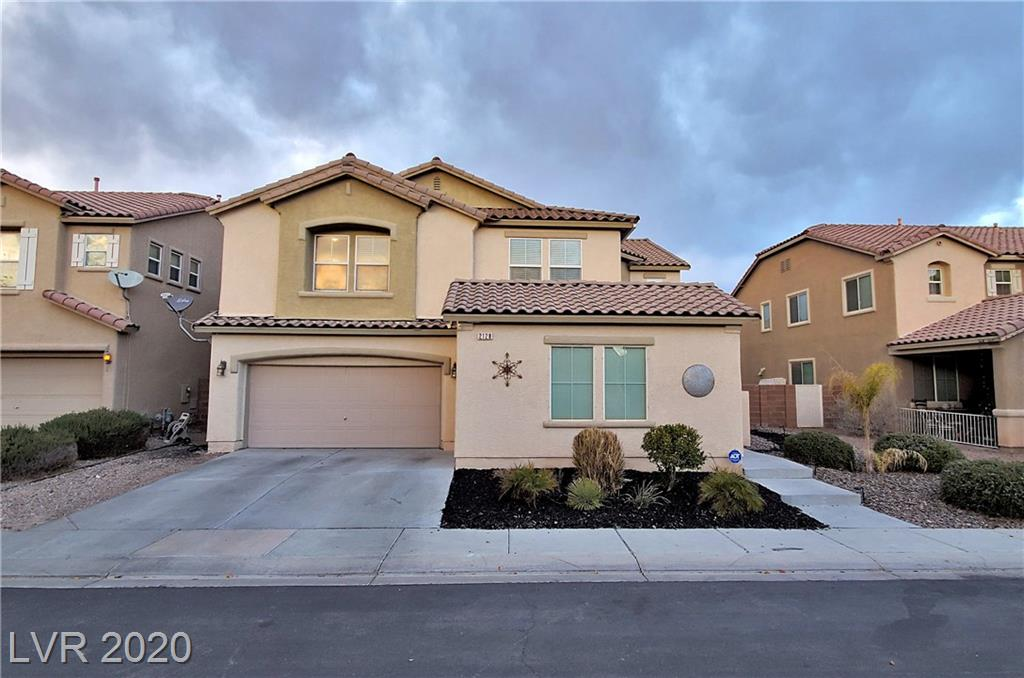 Stunning move-in ready home in desirable Aliante community. Open floor plan home with 5 bedrooms, large den and huge loft! Kitchen with plenty of cabinet space and built in desk. Brand new beautiful laminate flooring downstairs. Remodeled bathrooms. Oversized master bedroom with balcony, large bathroom and walk in closet. Backyard features recently built pool and separate green area. Side yard garden. Walking distance to Aliante Casino, parks, 2 schools and so much more! Must see!