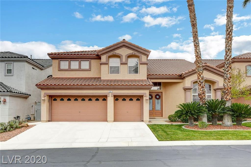 Rhodes Ranch Golf Course Community-Highly desirable 4 bdrm home in cul-de-sac, with inviting pool and rock waterfall. Stunning entry with curved stairway. Formal living & dining rooms, as well as 2 separate family room areas - one downstairs off kitchen with huge ceilings, one upstairs in 2nd loft area. *Unique loft area above master bedroom with private stairway & beautiful fireplace* Large open kitchen/family room area with fireplace & wet bar. Granite counters in kitchen with island, counter seating + separate nook area. *Shutters throughout* New carpet in family room and master bedroom. Living room and family room freshly painted. Amazing community facilities with reasonable HOA fee: gym, leisure pool, lap pool, aquatic playground, tennis courts, pickle ball court under construction, basketball court, 2 racquetball courts, playground area....and scenic walkway around the beautiful golf course. What more could you ask for?  Must see!