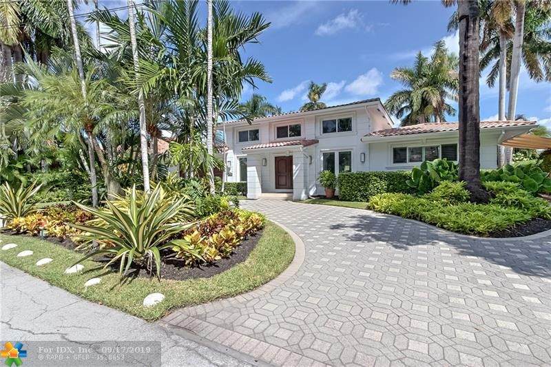 """This very well priced Harbor Beach listing checks all the boxes for the Buyer that wants to just move in or build new! This is a """"Must See"""" gracious, comfortable & well maintained custom 4 Bedroom / 4 Bath waterfront estate home on a large lot with new seawall cap & 95' concrete dock for your yacht. Just seconds to Intracoastal & mere minutes to Port Everglades Inlet / Atlantic Ocean with no fixed bridges. Current residence is light, bright & spotless that boasts spacious rooms, a two-story grand entrance foyer, custom European inspired gourmet kitchen, marble counters & flooring abound, all hurricane impact windows & doors, whole home emergency gas generator & the list goes on! Priced right for the new Owner or Investor that wants to build their dream home or modern spec home masterpiece."""