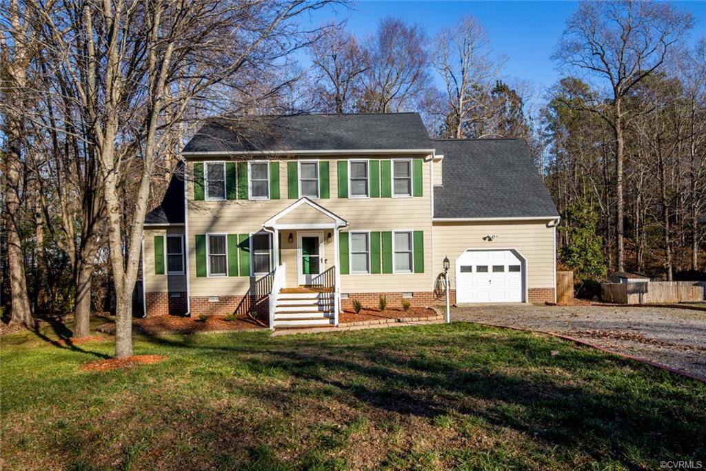 Dont miss this wonderful opportunity with this 4BR 2.5 Colonial style home loaded with updates.  Featuring just under 2000sqft, this home offers a BRAND NEW 30 YR ROOF, one car garage, awesome rear screened porch with ceiling fan, fully fenced in rear yard, multi tiered rear decking, double wide driveway, 2 zone HVAC system, pull down attic for storage, and yes thats just the beginning.  Fully renovated eat in kitchen boasting granite tops, newer cabinetry, double door pantry, tiled backsplash, stainless steel appliances, recessed lighting & chandelier.  Formal dining with engineered  floors and ceiling fan.  Spacious family room also with engineered flooring, ceiling fan, and gas fireplace.  Large utility room and half bath rounds out this awesome 1st floor.  Second floor master suite with vaulted ceilings, ceiling fan, walk in closet, wall to wall carpeting, and an updated full bath w/tiled floors, newer vanity, dual sinks, quartz tops, and a newer tub/shower combo.  Three other wonderfully sized secondary bedrooms all with large closet spacing and wall to wall carpeting.  This home is a must see and wont last long.  Come see it today!  And only 25 minutes from downtown Richmond!