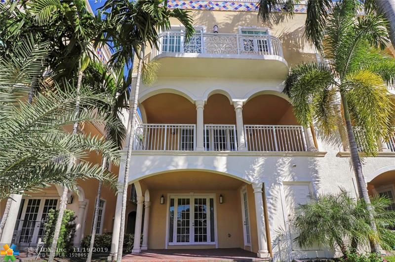 WATERFRONT, 3924 SF, PRIVATE DOCK! Enjoy the Las Olas lifestyle in this huge, end unit townhouse with private dock for up to a 50' boat. Upgraded gourmet kitchen, high end appliances, wall oven, rooftop terrace, two car garage, loft and den. Enjoy amazing waterfront views from two balconies and a third balcony off the kitchen. Large master bedroom with walk in closets and enormous masther bathroom with dual sinks, and separate tub and shower. High ceilings, impact windows and doors, marble and wood floors throught out, private gated driveway, two laundry facilities and elevator. This home has everything for a price that cannot be matched on the Las Olas Isles.