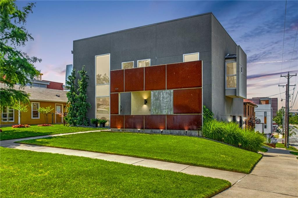 STUNNING CONTEMPORARY HOME IN MIDTOWN/SOSA. This is a rare find you don't want to miss, close to downtown, Scissortail Park & all the fun Midtown has to offer. Designed & built by an architect for their personal home, there was attention to every design detail right down to a hidden fireplace. The 1st floor has a living area w/wet bar, bedroom & full bath. Glass doors can enclose this area creating a fabulous, private 2nd bedroom suite. A custom staircase leads to the 2nd floor which is the main living area. Floor to ceiling windows offer a spectacular view of downtown & usher in amazing natural light. The kitchen is a chef's dream w/Quartzite waterfall island, Liebherr refrigerator/wine cooler, Jennaire double ovens, gas cook top, Bosch dishwasher & Scotsman ice maker. The study is tucked behind a dividing wall in the living room. The Primary bedroom has a spa-like ensuite bath w/soaker tub, double vanity & shower. Washer/dryer hookups on both floors. One of a kind balcony experience.