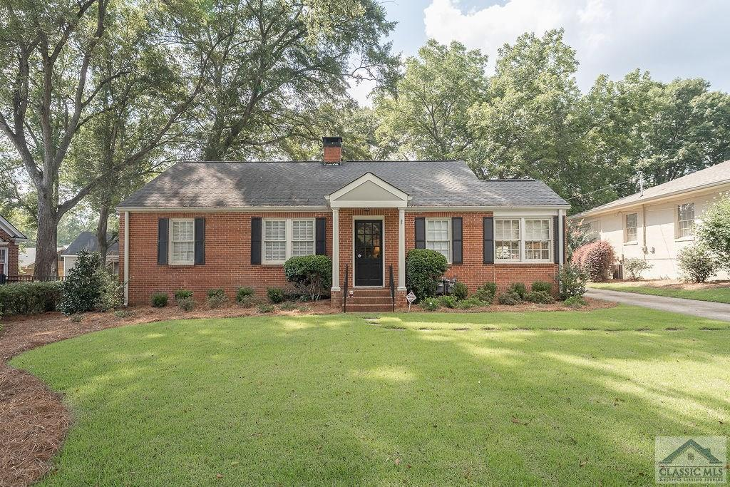 A beautiful classic Fivepoints  brick charmer with an additional income property, located in the heart of desirable Five Points Athens! This property is 1/2 a Mile Away from all the shops and restaurants that Fivepoints has to offer and is 1.5 Miles away from Sanford Stadium!  From hardwood floors to modern updated features everywhere, there is truly nothing not to love about this classic and elegant home! In the main dwelling you'll find 3 spacious bedrooms, 2 full-bathrooms, a gorgeous sunroom, a fully operational fireplace, and space everywhere in-between! The classic formal dining room and stunning bright kitchen is a homeowner's delight! The additional private 1 bedroom/1 full-bathroom structure located on the property offers ample income opportunities. Included in this structure is a full-kitchen and generous sized  living area with another fully operational fireplace.   **430 Milledge Terrace (Main House) is 3 bedroom, 2 bathroom, 1561 Square Feet. 430 1/2 Milledge Terrace (Guest House) is 1 Full bedroom, 1 Full bathroom, Living area, & complete kitchen, 770 Square Feet. All Kitchen appliances in both properties are only 1 year old. A beautiful move in ready charming 5Points Home with a guest house to bring in additional income, all for less than $700K! Schedule your private appointment today!