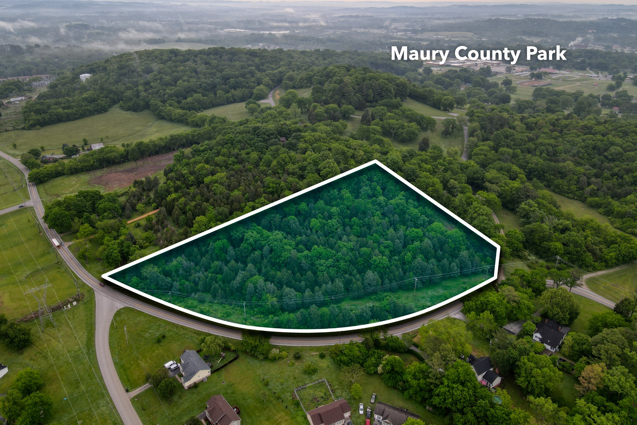 Privacy & Seclusion!  Right about 7 Acres Nestled near the Heart of Columbia!  Offering 1030 Feet of Road Frontage. This Beautiful wooded area backs right up to Maury County Park!  Property has a couple of Beautiful Potential Building Sites for a home or HOMES! Electric and gas located at the road, all other utilities including sewer, water, high speed fiber optic cable located across the street. Come see all of the potential this Oasis has to offer!! No percolation test has been performed.