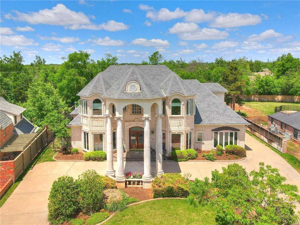 What a rare opportunity to stumble upon this glamorous one-owner home located on over half of an acre in Nichols Hills. The arched wood-framed windows, soaring ceilings, sweeping staircase, and gloriouslibrary are just the beginning of what you will find in this custom home. The owner's suite and lavish bath is large with incredible windows and builtins. All roomsare spacious, each bedroom (2 down, 3 up) is accompanied with anen-suite bathroom and large walk in closets. The bonus room has a back staircase leading to the cook's kitchen. Abundant storage throughout as well as opportunity to transition the walk-in attic space into an additional room. Enjoy coffee on the second floor balcony overlooking the huge backyard with a large swimming pool and spa, outdoor dining and living areas, and beautiful lawn. Front circle drive, back-entry garage, mature landscaping, interior sprinkler system, and much more. Just down the street from Bixler Park and a quick walk to NH Plaza.