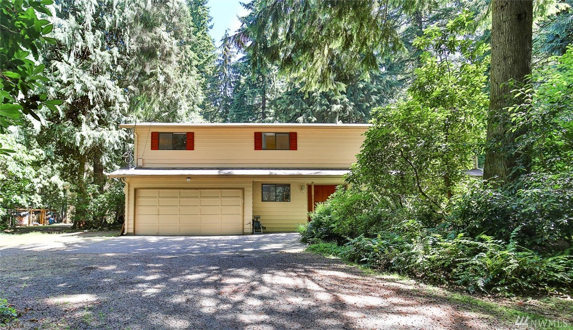 Quintessential Pacific NW beauty! Located on a 1.26 pvt & level wooded estate, this updated 2-story offers spaciousness & easy flow from room to room! 4 bdrm + office + bonus! Fresh paint & new carpet. Beautiful updated Chef's kitchen w/center isl, granite, sunroom adj, heataltor frplc in LR, tons of storage, garden windows, 2 staircases, huge bonus room! Frplc in master! NEW ROOF & EXT PAINT, HUGE SHOP! Raised garden beds & apple trees! Flex indoor & outdoor spaces! Peace and serenity!!