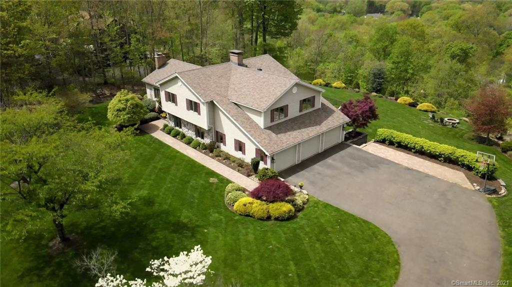 One of a kind custom built split-level home in highly sought after Copper Ridge Road. Double cul-de-sac location on 1.84 acre lot. This home is beautifully situated on the view side of the ridge and offers gorgeous unobstructed views of Southington and beyond! Enjoy everything from the brilliant vibrant fall foliage to the most stunning summer sunsets. This 4 bedroom, 3.5 bathroom home has plenty of room for family and friends. Inground pool and lovely backyard complete with fire pit. Entertain or simply sit back and enjoy the tranquility, mature trees, and picturesque mountain views Copper Ridge is known for. Unique open floor plan that shows quality and care. Professionally landscaped, irrigation system, two new energy efficient AC units 2019, newer 30 year architectural roof, pool liner and filter in 2015. Vaulted ceilings in living room and dining room, granite counters, three fireplaces, tray ceilings, hardwood flooring, home security system, and generator hook ups are just some of the features you will find in this amazing home. The master bedroom suite will definitely become your retreat! Gas fireplace, tray ceiling with crown moulding accent lighting, walk-in closets, and sliders that lead you to your own private balcony that overlooks the valley. Full lower level with walk out to inground pool and patio area. Best of all you are only a short walk away to the north end cul-de-sac where you will find 67 acres of open space to hiking trails. Welcome to your new home.